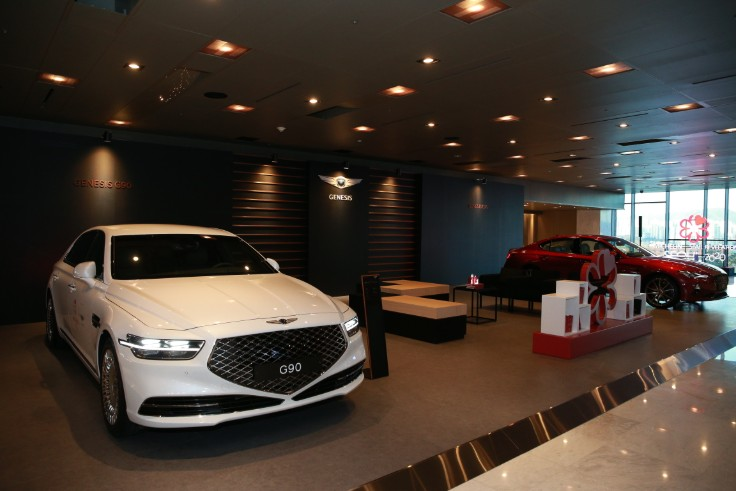 The G90 and G70 luxury sedan models of Genesis on display at the Vista Hall ballroom foyer.