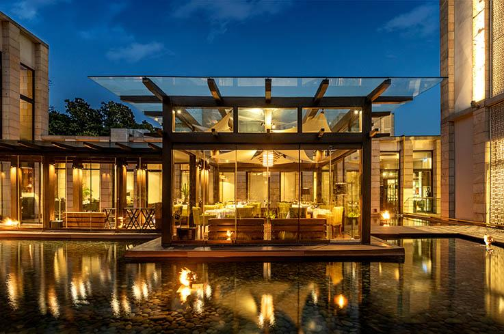 The glass house at Indian Accent at The Lodhi Hotel in New Delhi. (Photo by Rohit Chawla.)