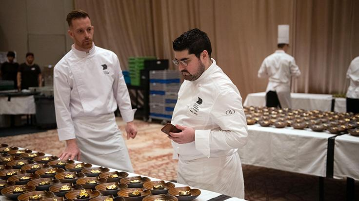 Chef de cuisine of Alain Ducasse at Morpheus, Pierre Marty, and his team prepare the evening's course.