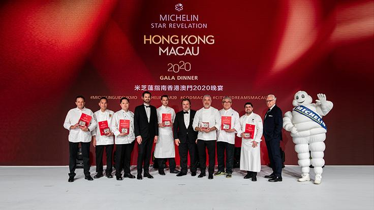 All seven guest chefs of the evening on stage with International Director Of The MICHELIN Guides Gwendal Poullennec.