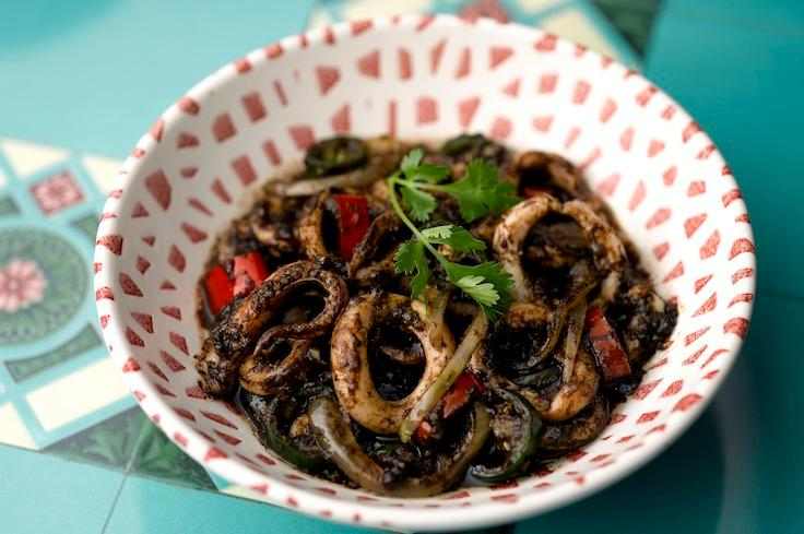 Signature Sotong Keluak where pungent Indonesian black nut paste is matched with rings of fresh squid. (Photo: The Blue Ginger)