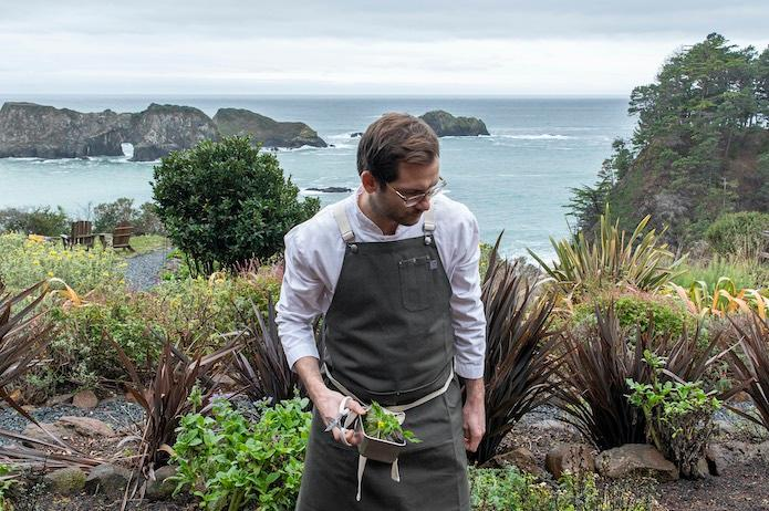 Chef Kammerer gathers ingredients for his tasting menu from the property gardens. © Brendan McGuigan