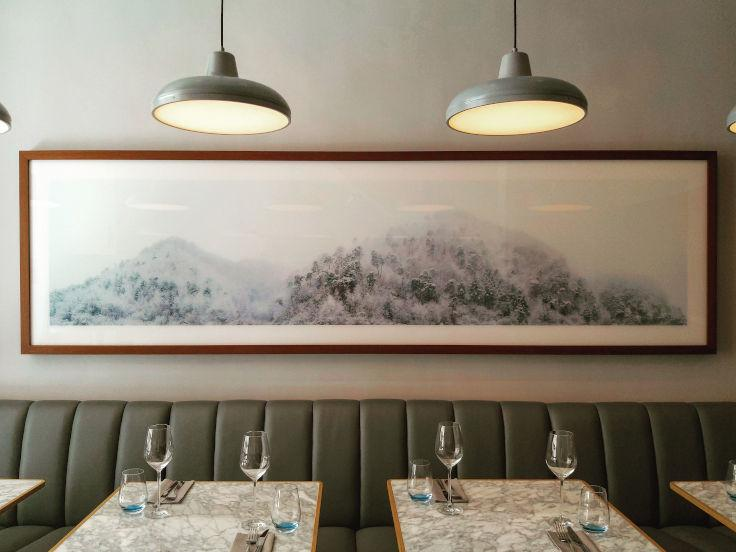 The decor at Cornerstone is minimalist and on the wall is the work of Boomoon, a Korean photographer whom Osborn admires (Photo: Cornerstone)