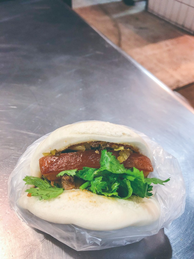 Yuan Fang Guabao is a 60-year-old shop popular for its buns stuffed with marinated pork belly, pickles, ground peanuts and coriander.