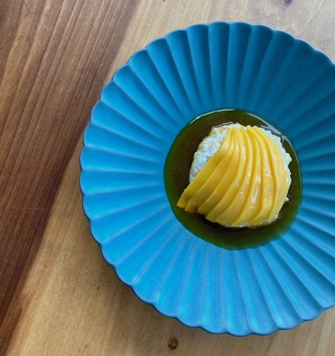 The collaboration between Lord Stanley and Mister Jiu's resulted in dishes like mango over coconut pudding. Photo courtesy of Lord Stanley.