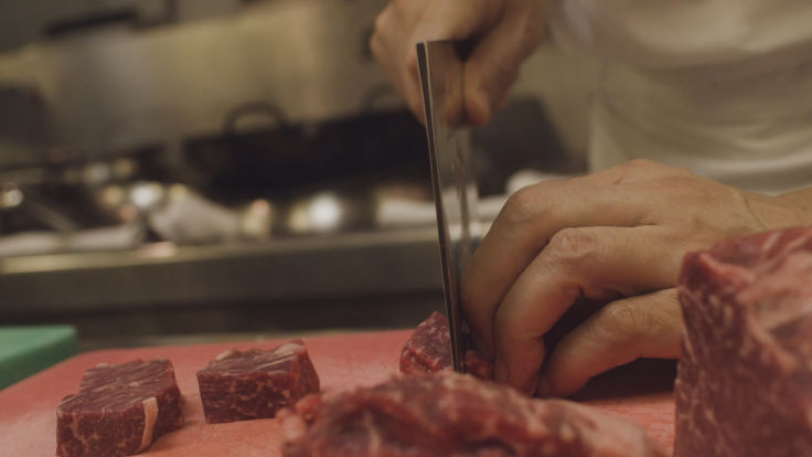Dicing beef into one-inch cubes is a new attempt for chef Lau.