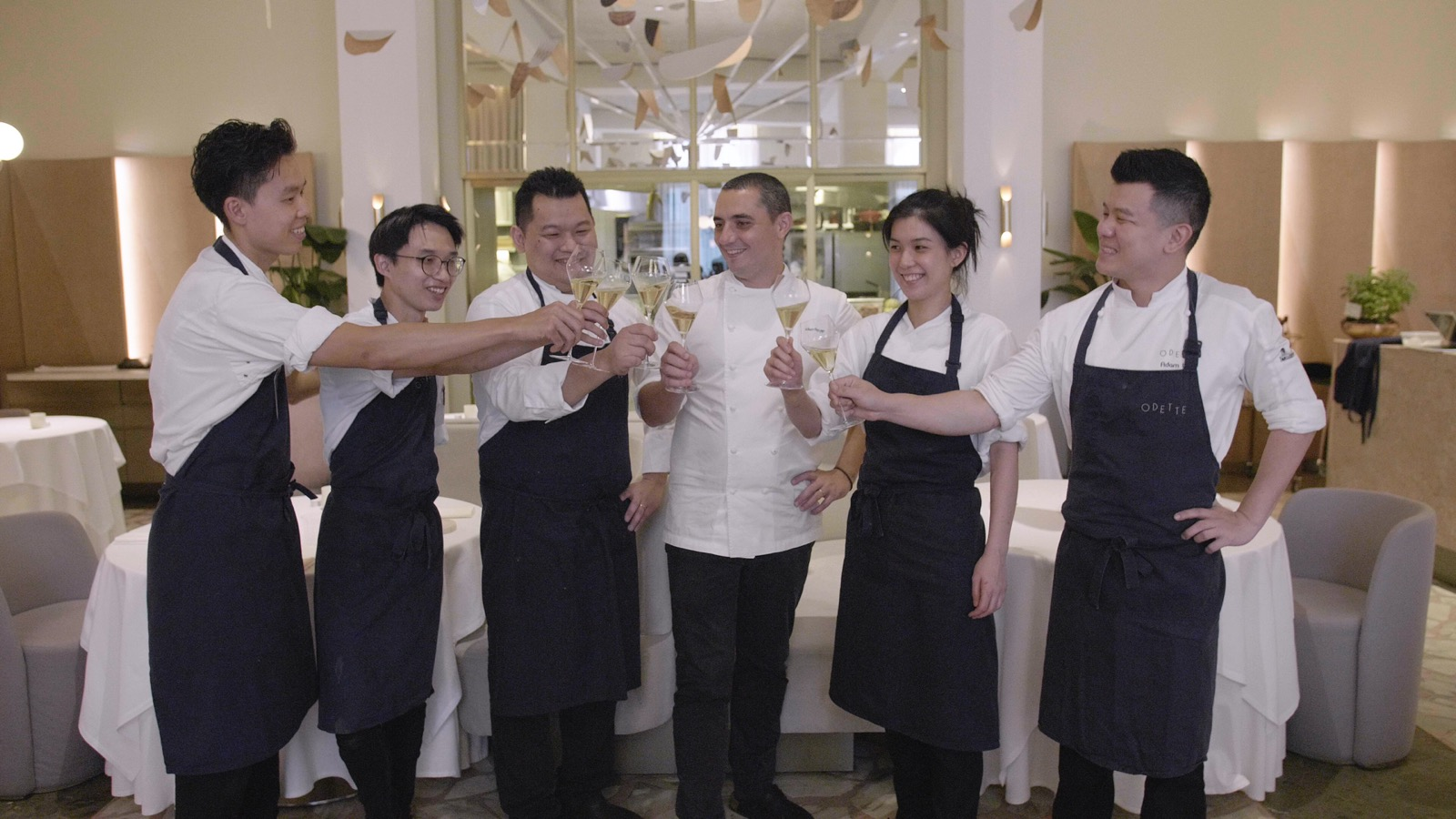 """The """"Merchants of Happiness"""" (from left): Sous Chef Sheng Xiong Yeo, Junior Sous Chef Jonathan Gan, Executive Chef Levin Lau, Chef-owner Julien Royer, Pastry Chef Louisa Lim and Chef de Cuisine Adam Wan. (Photo: MICHELIN Guide Digital)"""