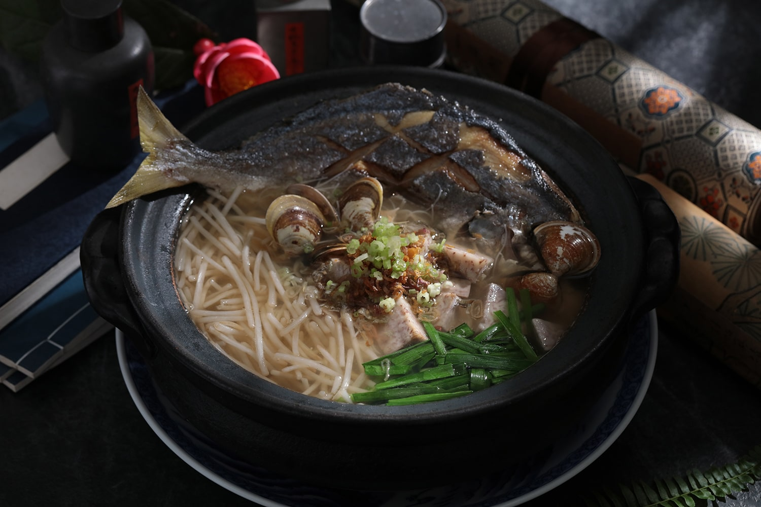White pomfret noodle soup from one MICHELIN-starred Mountain and Sea House.