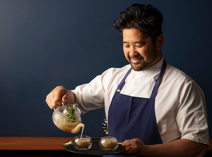 Brandon pouring Tiger Milk Tea Punch. Photo by Colin Peck