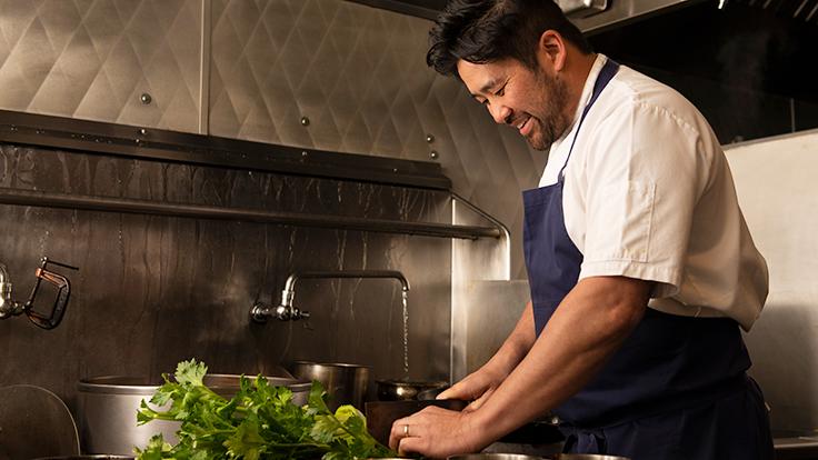Brandon in kitchen. Photo by Colin Peck