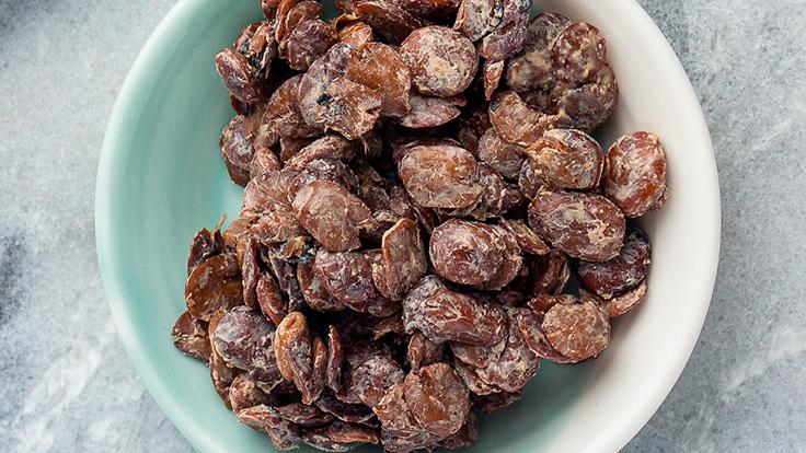 Iru or fermented locust beans. © Abimbola Olayiwola/Shutterstock