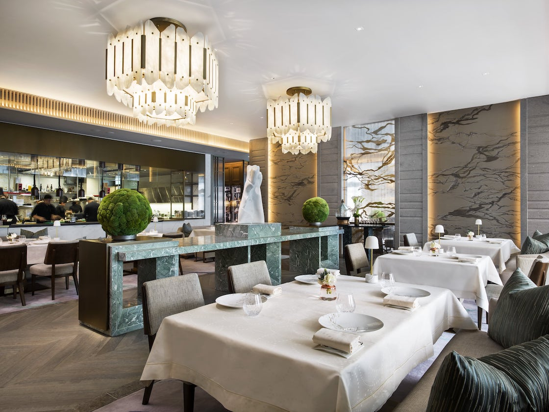 Main dining room with open kitchen at L'Envol, designed by André Fu. (Photo: Courtesy of L'Envol)