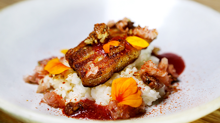 Tail Up Goat's Carolina gold rice with braised pork belly, candied pecans and strawberry vinegar. Photo by Mat Ramsey, courtesy of Tail Up Goat