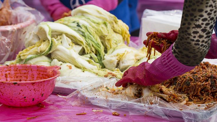 Communal kimchi making in winter. Photo © bong hyunjung/iStock