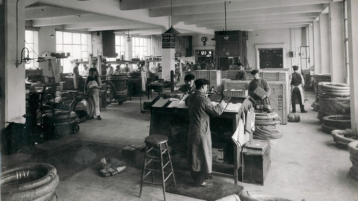 One of the tyre-fitting workshops at Michelin House, circa 1912