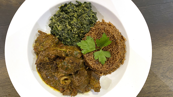 Swahili Village's goat stew, Mbuzi Mchuzi with pilau and spinach. Photo by Michelin North America