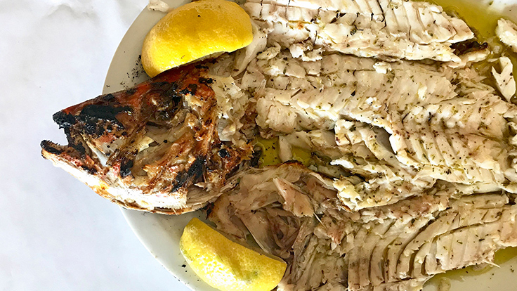 Mythos's chargrilled fish. Photo by Michelin North America