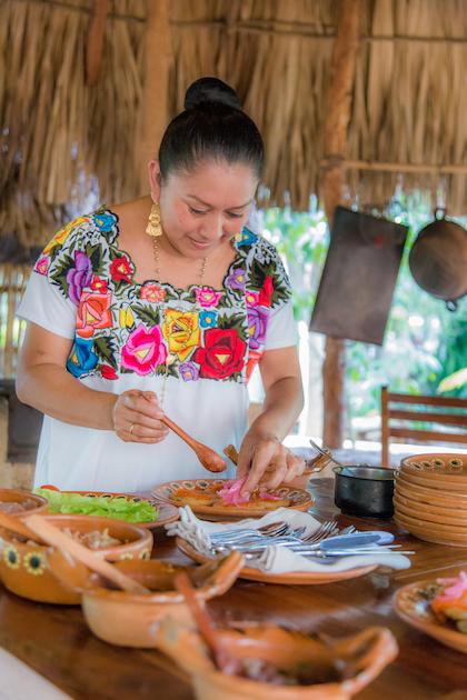 A Mayan chef prepping cochinita pibil at Chablé Yucatán's Casita Maya. Photo courtesy of Chablé Yucatán