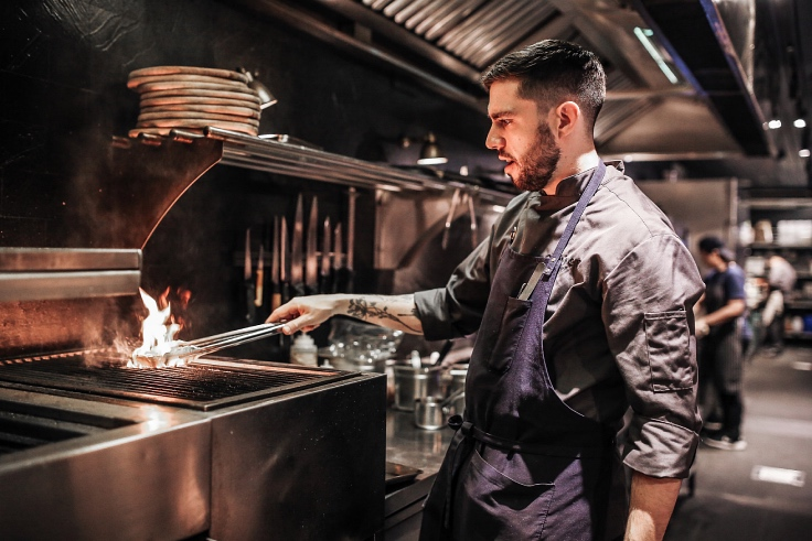 Chef Doucakis on the grill. (© Quince)