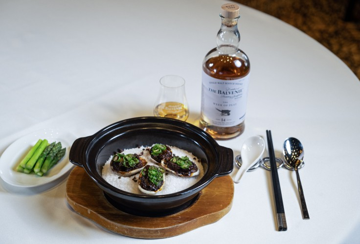 Shisen Hanten's Salt-baked Live Abalone with Szechwan Sauce, paired with the honey, vanilla and citrus notes and a delicate layer of smokiness in The Balvenie's The Week Of Peat.
