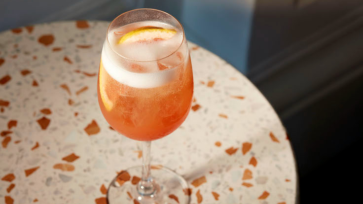 Alba Rossa, Osteria BBR's own take on the classic Aperol Spritz. (Photo by Raffles Hotel Singapore)