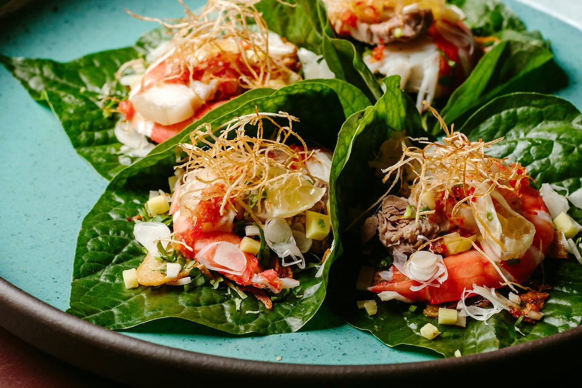 Betel leaf with pork and prawn salad with som saa citrus (Photo: Courtesy of Aaharn)