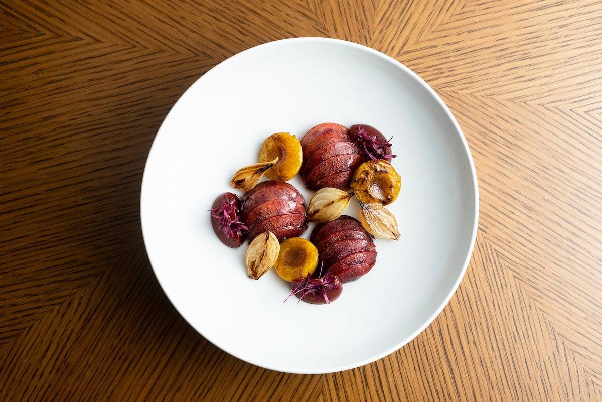 Crapaudine beetroot, plum, home-made umeboshi, pepper berry, yellow onion, cabernet sauvignon, amaranth (Photo: Courtesy of Amber)