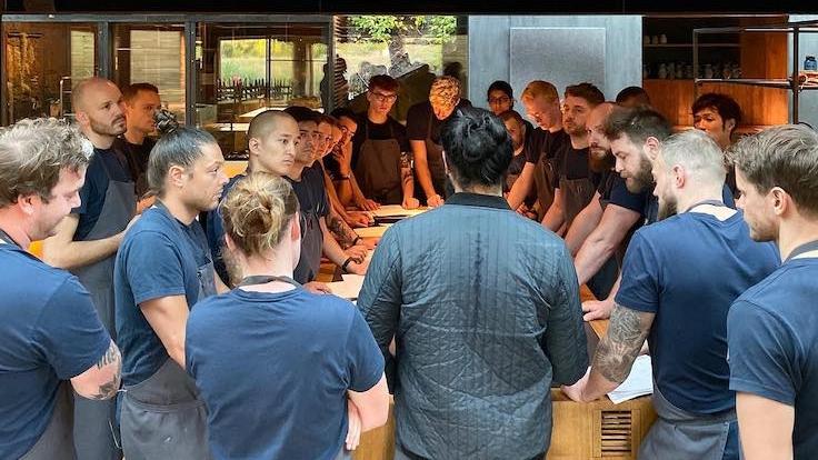 Foong at a team briefing before meal service at Noma.